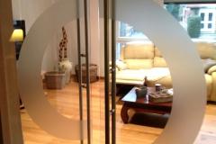 Motif circulaire pour double porte en verre