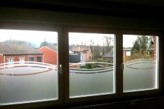 Sablé motif vague sur plusieurs fenêtres
